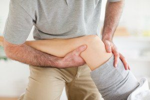 bigstock-Chiropractor-massaging-a-woman-23237318-300x200